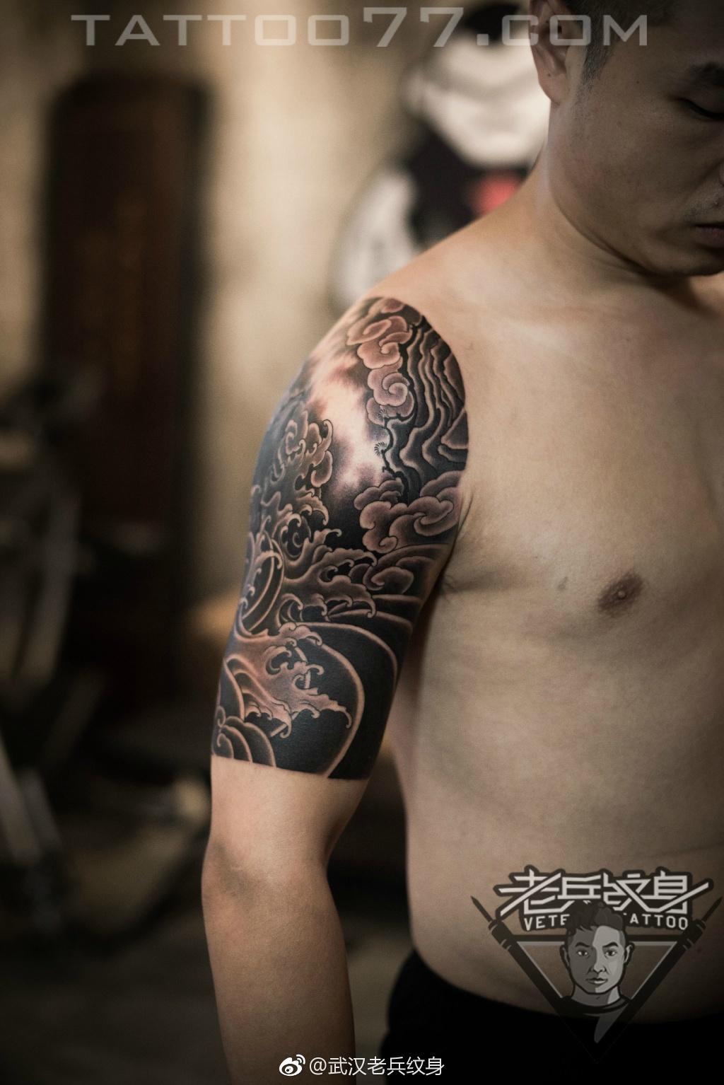 武汉大臂浪花纹身图案